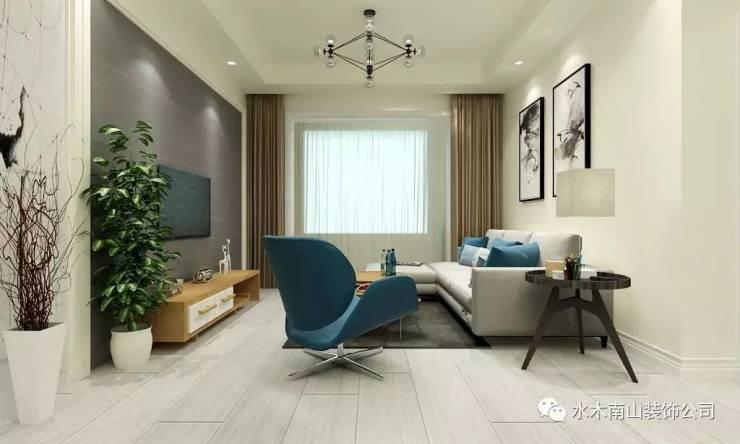 与深灰色的地毯相互辉映,几何造型的茶几以及原木色置物柜,将北欧极简